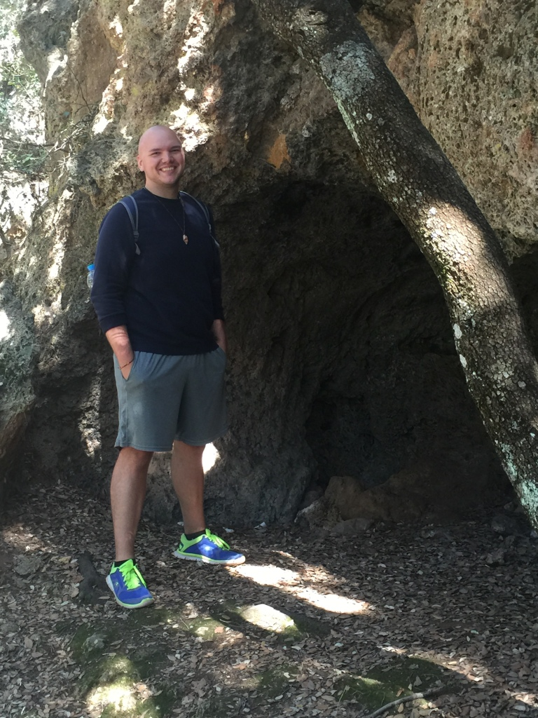 Me in front of a limestone cave, which are very common in the Mediterranean region.